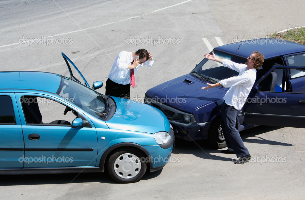Traffic accident - one driver on the mobile phone, second expressing anger — Stock Photo #1754025