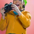 Excited girl holding a camera — Stock Photo