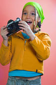 Excited girl holding a camera — Foto Stock