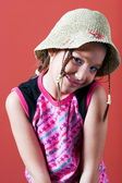 Shy girl with a hat — Stock Photo