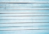Close up of a blue wooden fence — Stock Photo
