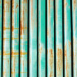 Stock Photo: Rusty Corrugated Iron Fence