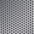 Stock Vector: Perforated metal background