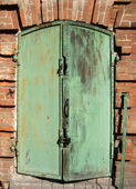 Backgrounds, Iron shutter on window — Stock Photo