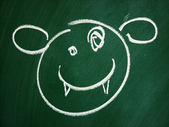 Blackboard smiley — Stock Photo