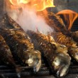 Stock Photo: Fish barbecue - fish on fire
