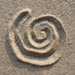 Spiral sign in sand — Stock Photo