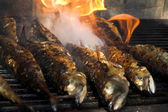 Fish barbecue - fish on fire — Stock Photo