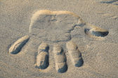 Hand sign in sand — Stock Photo