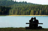 Couple by the lake — Stock Photo