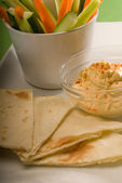 Hummus dip with pita bread and vegetable — Stock Photo