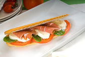 Panini caprese and parma ham — Stock Photo