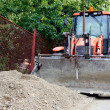 Bulldozer with pile of dirt - Stock Photo