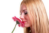 Girl smelling flower — Stock Photo