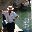 Gondolier - one of symbols of Venice - Stock Photo