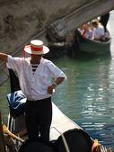 Gondolier - one of symbols of Venice — Stock Photo