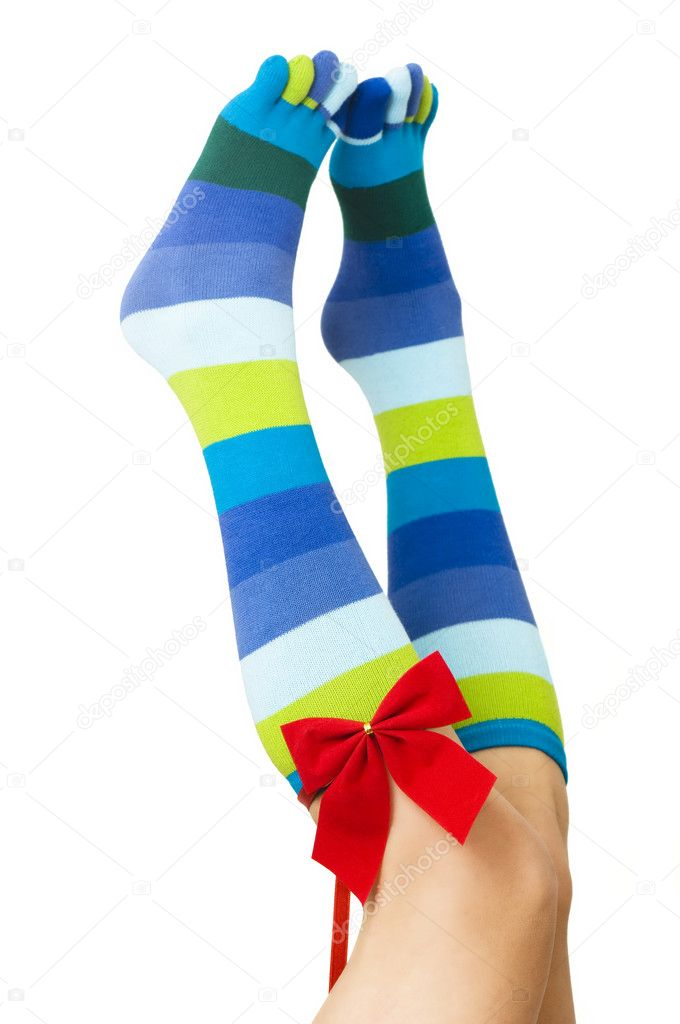 Sexy girl legs with day valentine socks as wrapped gift — Stock Photo #1815525