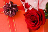 Day Valentine red rose and ribbon — Stock Photo
