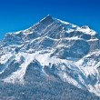 Stock Photo: Snowbound mountain peak.