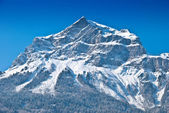 Snowbound mountain peak. — Stock Photo