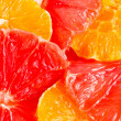 Close-up of grapefruit and orange slices — Stock Photo