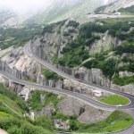 Serpentine road in Alps — Stock Photo