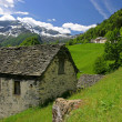 Stock Photo: Aged stone house in Swiss Alps