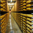 Stock Photo: Rows of cheese loafs