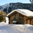 Stock Photo: A mountain hut covered by snow
