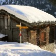 A mountain hut covered by snow — Stock Photo
