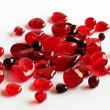 Aassorted red glass beads on white - Stock Photo
