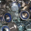 Screw-nuts with blue plastic gaskets — Stock Photo