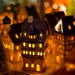 Christmas candle houses — Stock Photo