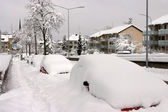 Parked cars buried under snow — Stock Photo