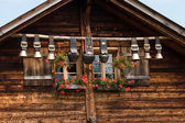 Decorative cow bells under the roof — Stock Photo
