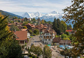 Swiss village with snowy peaks — Stock Photo