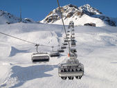 Ski chair-lift with skiers — Stock Photo