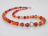 Red agate necklace with silver beads — Stock Photo