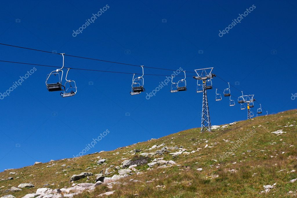 Empty cable cars against blue sky in a swiss ski resort in summer — Stock Photo #1805318