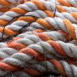Stock Photo: Worn twisted rope