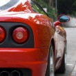 Back lights of a red sports car — Stock Photo #1892590