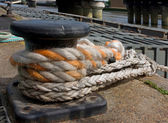 Mooring bitt with a rope — Stock Photo