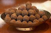 Dish of chocolate truffles — Stock Photo
