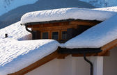Mountain house covered by snow — Stock Photo