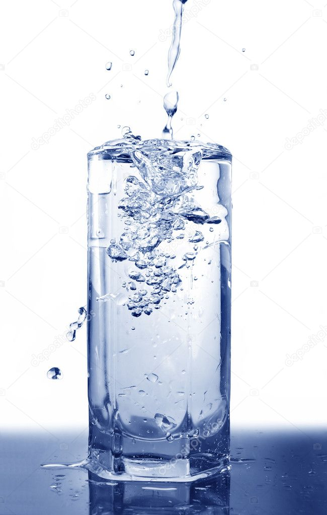 Big long drop of cold water poured into full glass (isolated on white background)                                      Photo #1765846