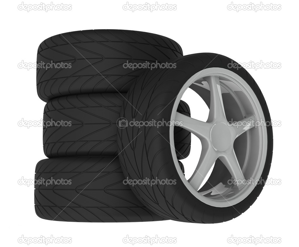 Heap of wheels with aluminium rims over the white background — Stock Photo #2009076