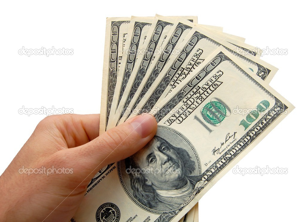 Hand holding a stack of cash, isolated on the white background — Foto de Stock   #2009499