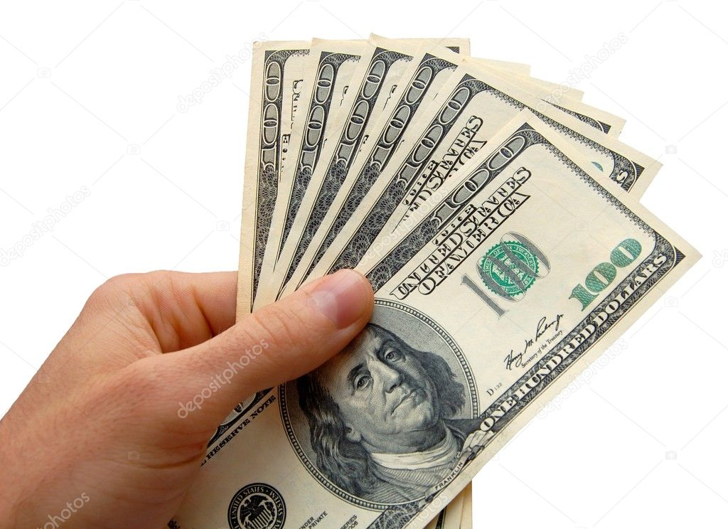 Hand holding a stack of cash, isolated on the white background — Photo #2009499