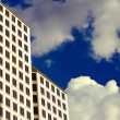 White High-Rise in the Clouds - Stock Photo