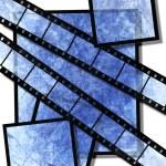 Blue film strip and film plates — Stock Photo